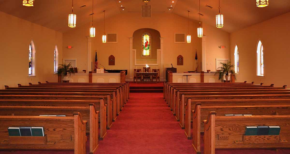 Gorgeous wood veneer church pews